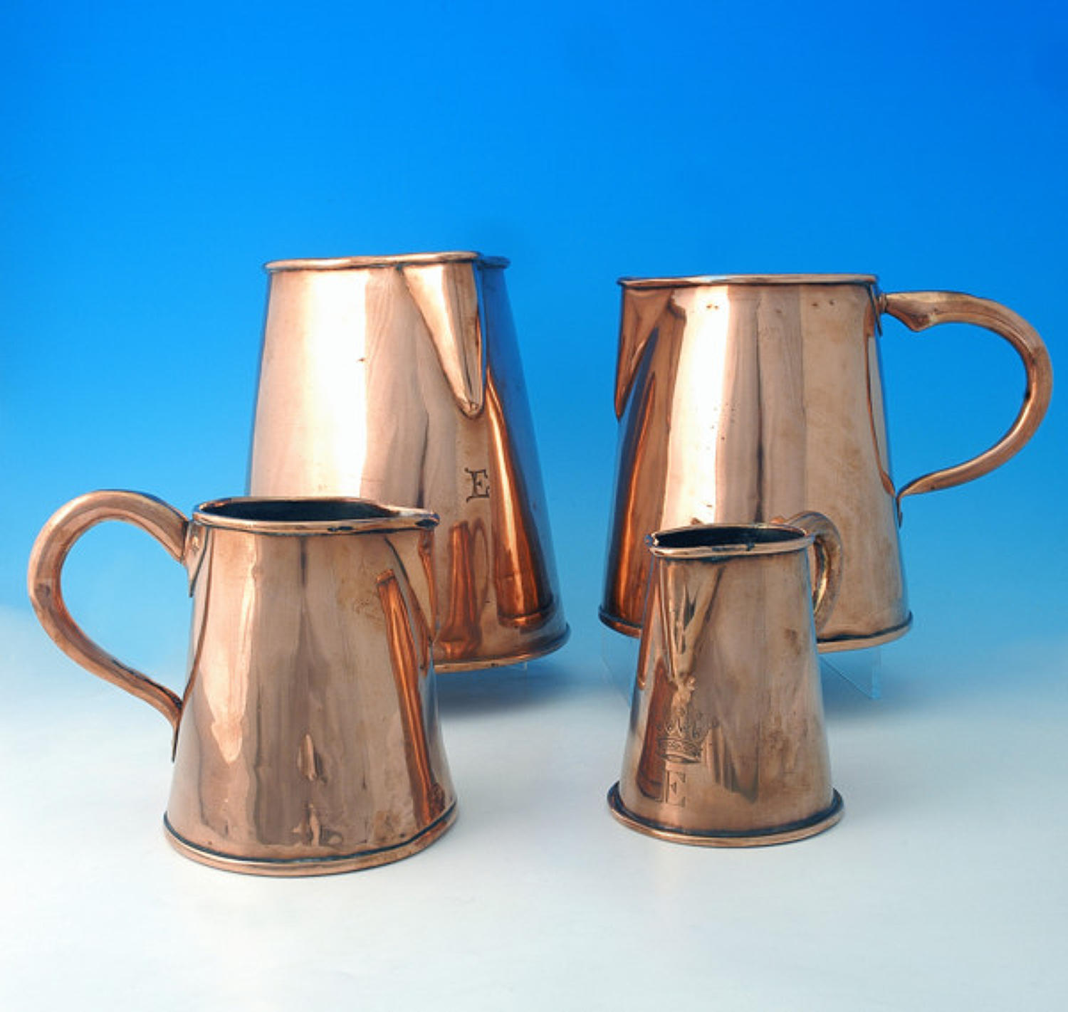 Set of four graduating Copper Jugs. English C1800