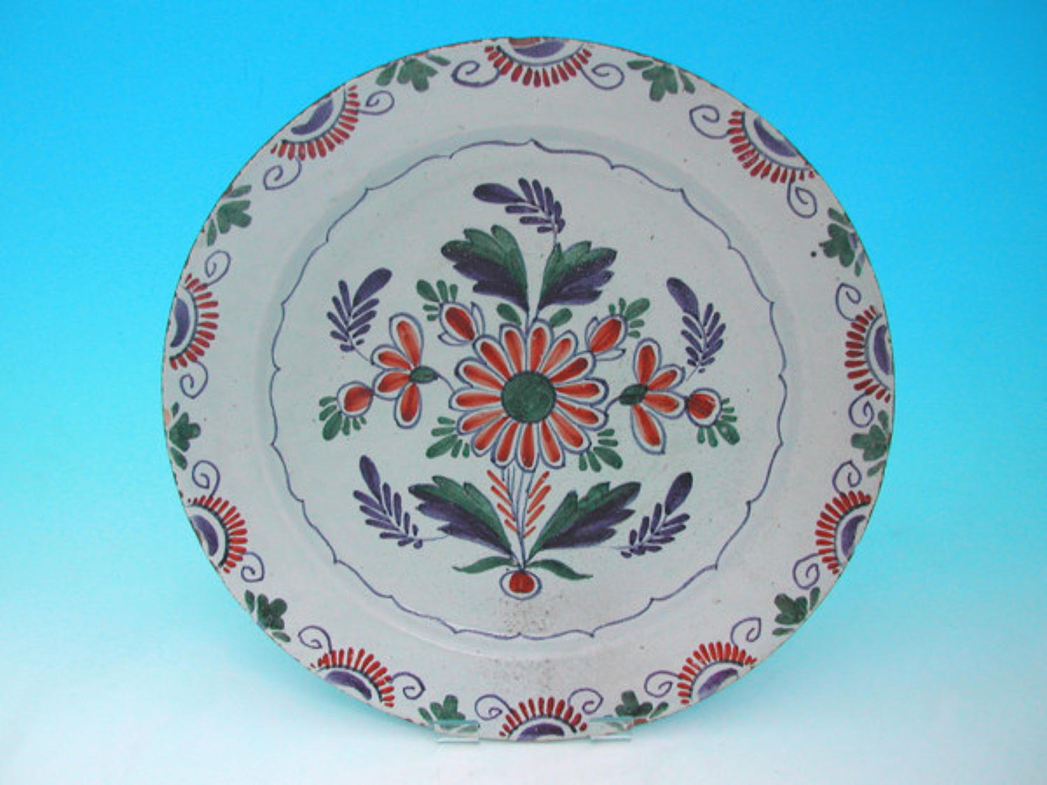 18thc Polychrome Delft charger showing flowers & geometric design. Eng