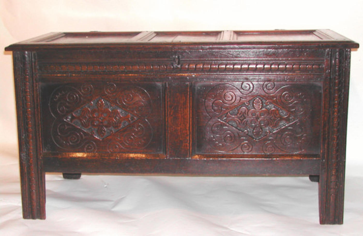 An early 17thc Oak panelled Coffer, English C1660 - 80