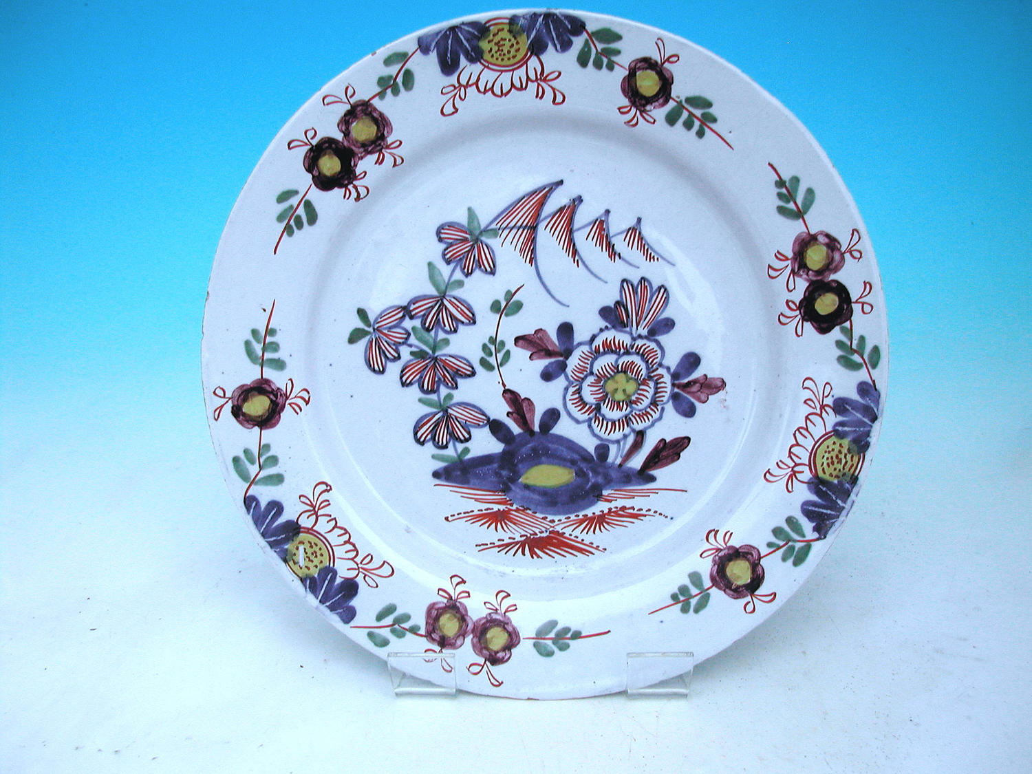 18thc English Polychrome Delft Plate Decorated With Flowers & Leaves.