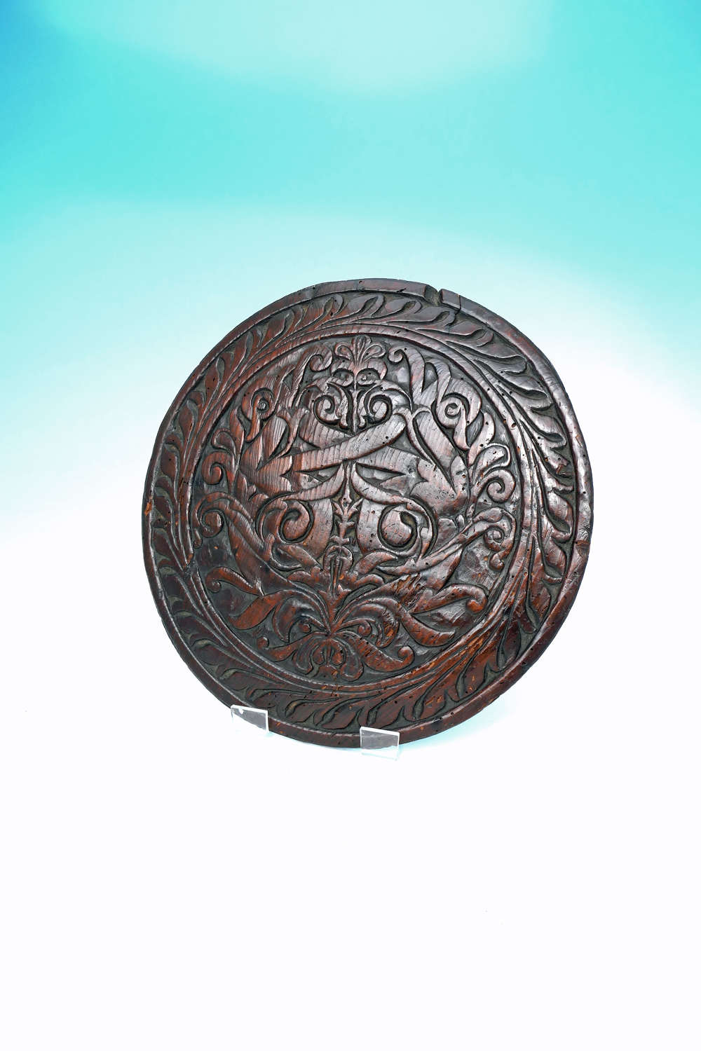Antique Carved 17thc Pine Roundel Decorated With A Floral Pattern.